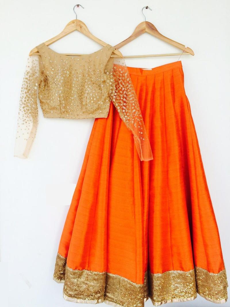 Orange lehenga with gold blouse